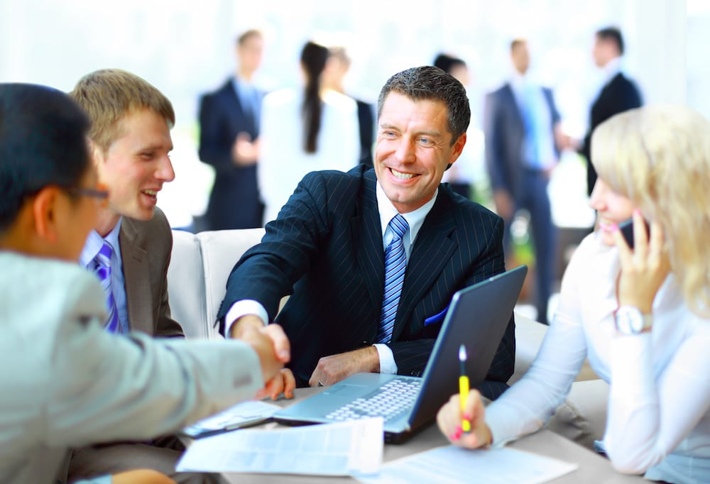 man shaking hands representing insurance bonds