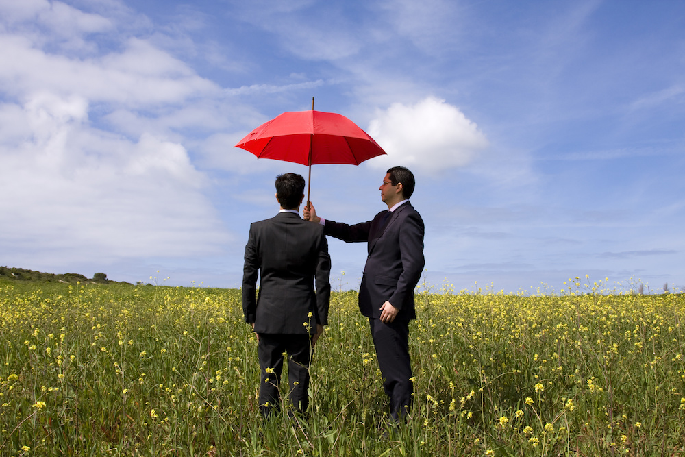 business man holding umbrella Potosi MO